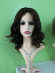 Wigs are a lush, full coverage hair replacement option